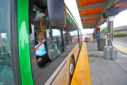 Geneisha Berry waits at a center running platform on an IndyGo electric bus, Monday, June 17, 2019, during a ride-along tour of the new Red Line stops.
