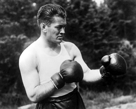American Gene Tunney, the World Heavyweight Champion, poses for photographers on the day of his fight with Tom Heeney in New York, USA, July 26, 1928.
