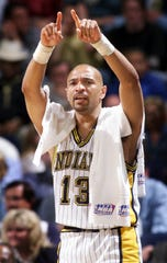 Mark Jackson (13) cheers on his teammates from the bench as the Pacers play in 1998.