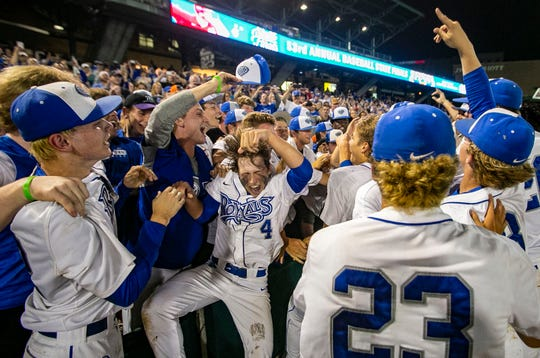 Hamilton Southeastern High School celebrates winning Class 4A IHSAA baseball state championship defeating Columbus East at Victory Field, Monday, June 17, 2019, Indianapolis.