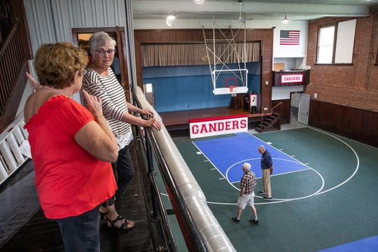 Linda Barnett (left) and Carolyn Fields talk on the balcony where bleachers once sat in the Mighigantown School gym on Monday, June 17, 2019.
