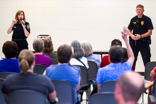 Iowa City Police Captain Denise Brotherton, left, speaks during a neighborhood meeting hosted by the Iowa City Police Department, Monday, June 17, 2019, at Mercer Aquatic Center in Iowa City, Iowa. Officer Adam Schmerbach, at right.