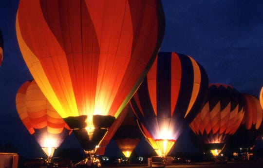 The glow of hot air balloons at night is a key draw for Mississippi Championship Hot Air Balloon Fest events on July 4 weekend.
