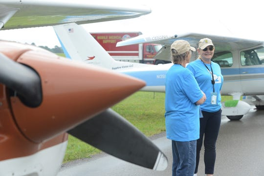 Pilots Mary Ann Richards and Stacey Budell talk in front of their plane in the 43rd annual Air Race Classic on June 18, 2019, at the McKellar-Sipes Regional Airport in Jackson. The event marks 90 years of women's air racing.