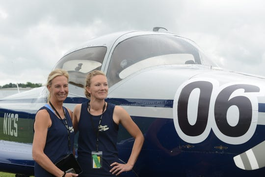 Ailsa Mosley Cutting and Sarah Wendt stand in front of Cutting's plane at the 43rd annual Air Race Classic on June 18, 2019, at the McKellar-Sipes Regional Airport in Jackson. The event marks 90 years of women's air racing.