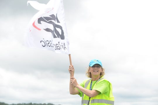Fixed Base Operation manager and start chair JoAnn Speer waves an Air Race Classic flag at the 43rd annual Air Race Classic on June 18, 2019, at the McKellar-Sipes Regional Airport in Jackson. The event marks 90 years of women's air racing.