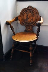 This carved wooden chair is at the top of the wooden staircase at Hopecote.