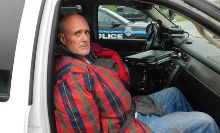 Newton County carjacking suspect Victor Edward Cihonski Jr. shortly after his arrest Monday afternoon near Plymouth.