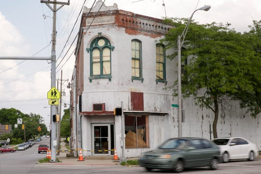 Traffic flows past the E.M. Weaver Building on the southeast corner of South and Main streets , Tuesday, June 18, 2019 at the Five Points intersection in Lafayette.
