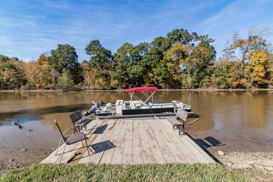 The south Lafayette mansion has its own dock to fish or boat on the Vermilion River.