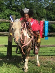 Arie Lewis, 2, showing off her tiaras and pony, Pepper. She was crowned Louisiana's Our Little Miss Personality Plus over the weekend.