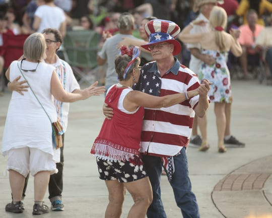 Sheila and  Roger Chautin dance to Geno Delafose and French Rockin' Boogie during the Uncle Sam Jam to celebrate Independance Day, at Parc International in Lafayette Monday, July 3, 2017.