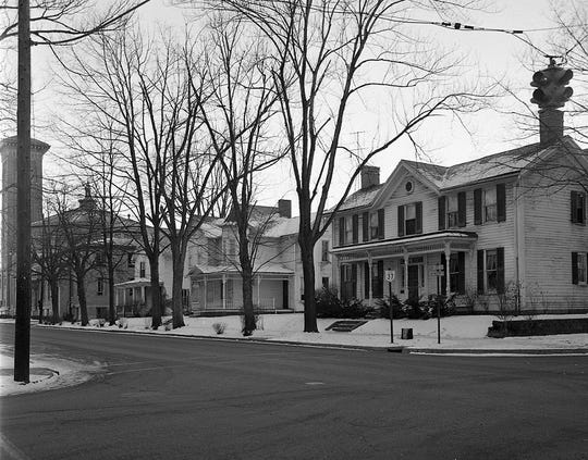 The First Methodist Church purchased these three properties and announced the purchase with an article and this photo in the E-G Jan. 11, 1962. The center house was the Busby home at 225 N. High St. These three houses were razed for a parking lot. Photo from the Duke Ellis Collection of the Fairfield County Heritage Association.