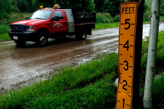 A truck drives down a mud-covered Mount Zion Road Tuesday, June 18, 2019, in Greenfield Township. Continued rain in area in the coming days could cause flooding on low laying roads like Mount Zion.