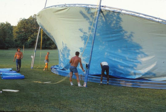 Volunteers set up the concert shell for the 1985 Lancaster Festival.