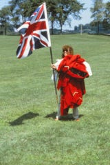 Barbara Hunzicker carries costumes and a flag for a performance at the first Lancaster Festival in 1985.