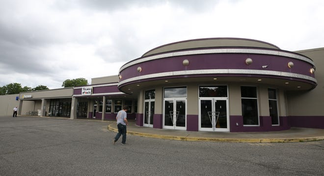 The rear entrance to the Mid City Mall is anchored by the Filmworks movie theater.