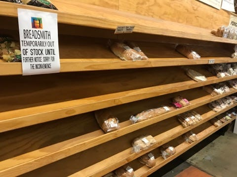 This photo taken early Monday night at Horrocks Farm Market in Delta Township shows a sign telling customers in the bread section that Breadsmith products aren't available for sale.