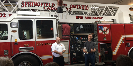 Springfield Township Trustee Robert Currens welcomes new Springfield Township fire Chief Matt Carey during a swearing-in ceremony at the main fire station on Monday night.