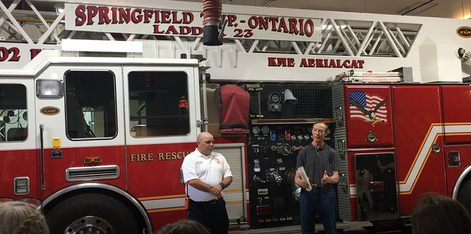 Springfield Township Trustee Robert Currens welcomes new fire Chief Matt Carey during his swearing-in ceremony at the main fire station in this News Journal file photo.