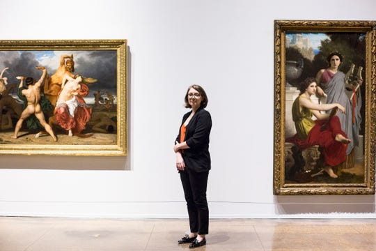 """Dr. Rosamund Garrett, the new Brooks associate curator, stands in the soon-to-be-open exhibition  """"Bouguereau & America"""" on Monday in Memphis, Tenn. The exhibition runs from Saturday to Sept. 22 at the Memphis Brooks Museum of Art."""