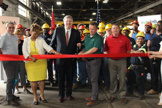 Memphis Mayor Jim Strickland and Greater Memphis Chamber President Beverly Robertson join representatives from Cleveland Track Material and its parent company Vossloh North America in ribbon cutting to celebrate Memphis manufacturing plant expansion.