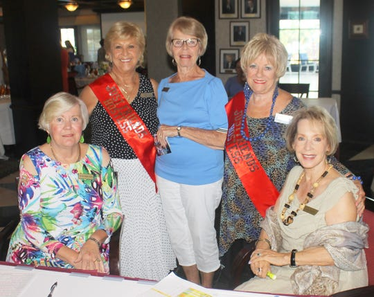 Welcoming the ladies are Hildie Kyes, Bonnie Bozzo, Marilyn Kostelnik, Pam Shudes and Ann Faruol.