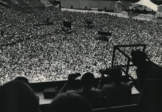 Police officers in the mezzanine at Milwaukee County Stadium use field glasses to scrutinize the crowd during the Rolling Stones concert on June 8, 1975. More than 100 people were arrested at the show, which drew 57,000. This photo was in the June 9, 1975, Milwaukee Journal.