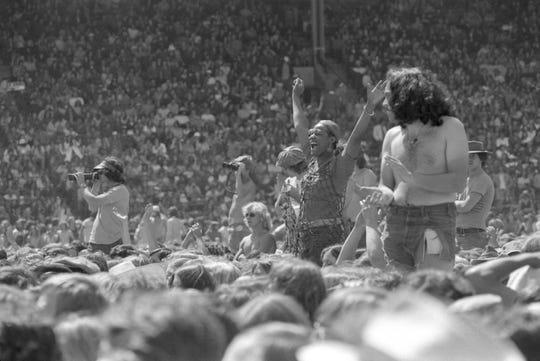 Fans get into the music (and scope out others in the crowd) during the Rolling Stones concert at Milwaukee County Stadium June 8, 1975. This photo was in the June 9, 1975, edition of The Milwaukee Journal.