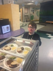Joshua Harris' favorite thing to do at Every Child's Place is to help out by pushing the lunch cart.