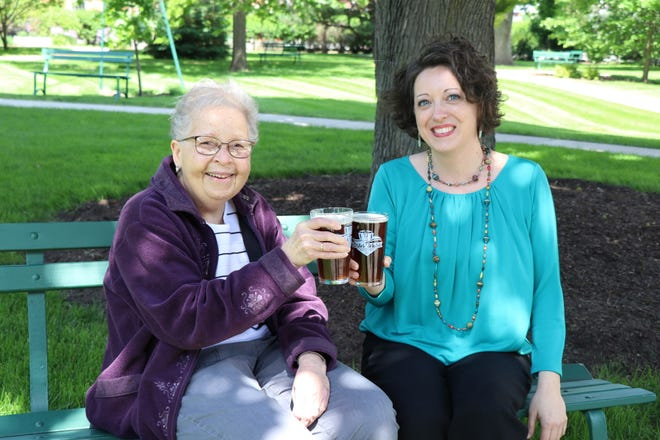 Sister Frances Cunningham, past president of the School Sisters of St. Francis, and Kari Hamende enjoy a beer at the St. Joseph Center where the beer gardens will be held.