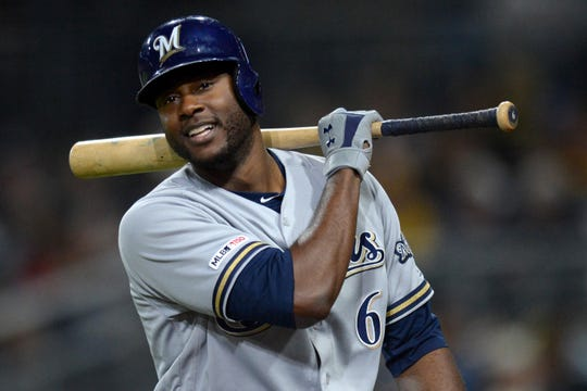 The Brewers' Lorenzo Cain is upset after striking out against the Padres.