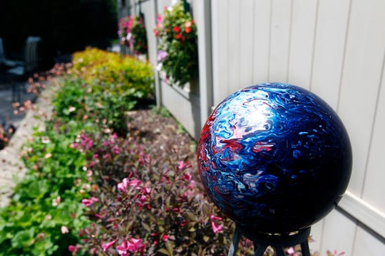Colleen's old bowling ball now serves as garden art.