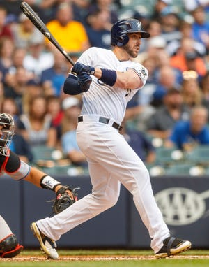Jun 4, 2019; Milwaukee, WI, USA; Milwaukee Brewers third baseman Travis Shaw (21) singles during the second inning against the Miami Marlins at Miller Park. Mandatory Credit: Jeff Hanisch-USA TODAY Sports