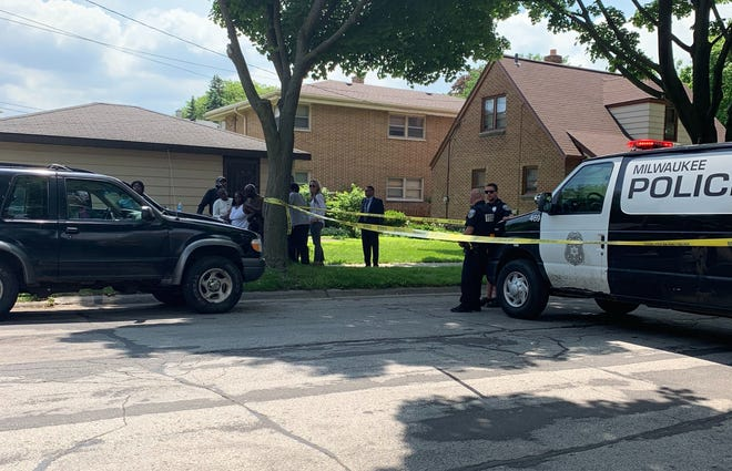 Officers and neighbors gather at the scene of a fatal shooting of a 5-year-old boy on Milwaukee's west side Tuesday afternoon, the second young child in as many days to die in southeastern Wisconsin in a shooting. Milwaukee police are still investigating the fatal shooting, which occurred in the 3200 block of North 45th Street.