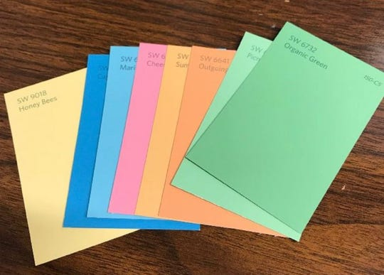 These paint cards show some of the possible colors that will be used by Care Center Ministries to brighten up Hickory Park.