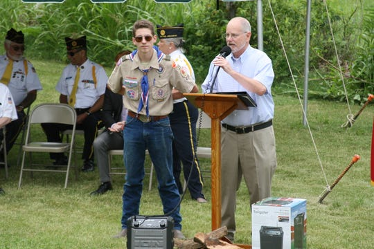 Eagle Scout Cody Marquis of Boy Scout Troop 156 (left) receives the Mayor's Certificate of Appreciation from Cotter Mayor Mac Caradine during a dedication ceremony Saturday afternoon.