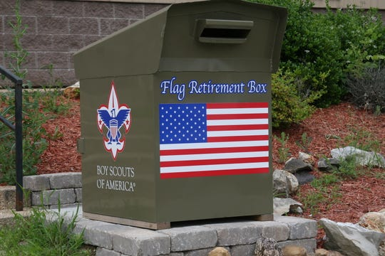 "Part of Eagle Scout Cody Marquis' Eagle Badge Project was repurposing the old Hasting's video return box to serve as a ""Flag Retirement Box"" in front of the Cotter Fire Department."