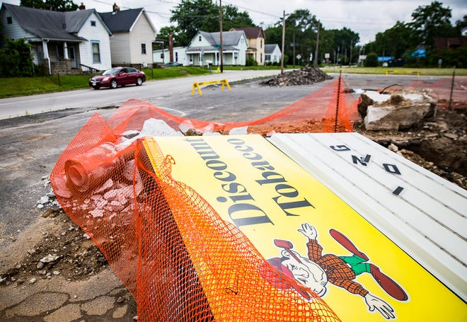 A signpost is positioned on the ground at the former site of Low Bob's Discount Tobacco on E. Jackson Street Tuesday.
