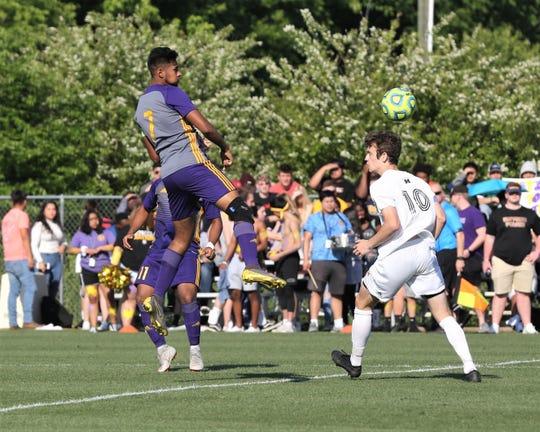 Smyrna's Jose Bustillo (7) heads the ball during a region soccer win over Hendersonville.