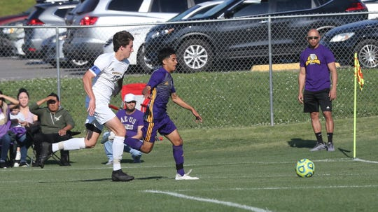 Smyrna's Omar Arradi battles a Hendersonville player for a loose ball during a region contest.