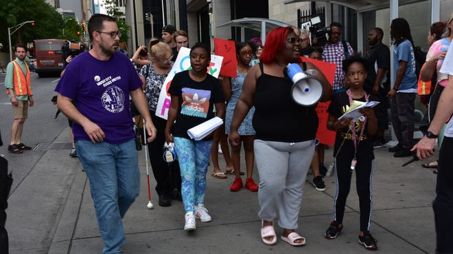 Angelique Johnson leads protesters as they march from the Music City Central bus station to city hall  on Tuesday, June 18, in Nashville, Tenn.