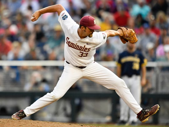 Florida State pitcher Chase Haney (33) hurls in a pitch during the game against Michigan in the 2019 NCAA Men's College World Series at TD Ameritrade Park Monday, June 17, 2019, in Omaha, Neb.