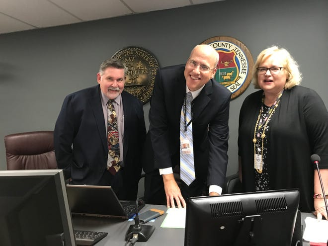 Jason Golden signs the contract to become superintendent of Williamson County Schools on Monday, June 17, 2019. He is joined by school board chairman Gary Anderson and school board member Nancy Garrett, who also signed the four-year contract, after the board voted to unanimously approve it.