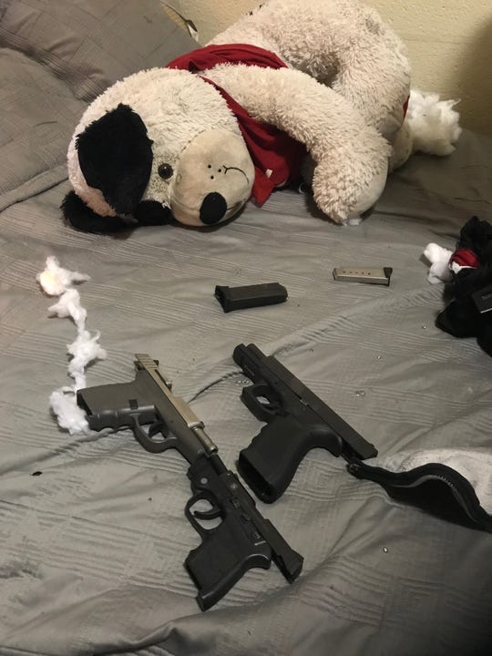 Police say they found three loaded guns inside a teddy bar during an investigation Saturday, June 15, 2019