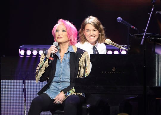 Tanya Tucker, left, and Brandi Carlile perform at Loretta Lynn's 87th birthday tribute at Bridgestone Arena on April 1, 2019, in Nashville.