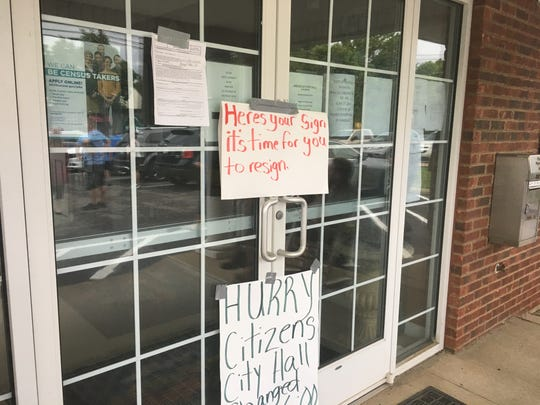 Ridgetop residents expressed their frustration with City Hall over the canceled meeting by taping signs of their own to the door on Monday, June 17, 2019.
