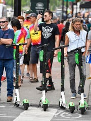 Scooters are seen among pedestrians in downtown Nashville.