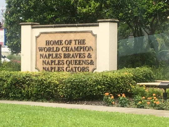 A sign along U.S. 41 East recognizes Naples' youth sports champions