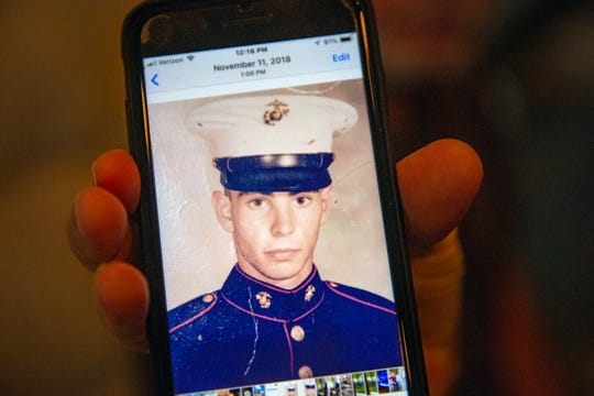 Joseph Mattera shows a photo of himself in his Marine Corp uniform, Tuesday, June 18, 2019, at his home in East Naples.